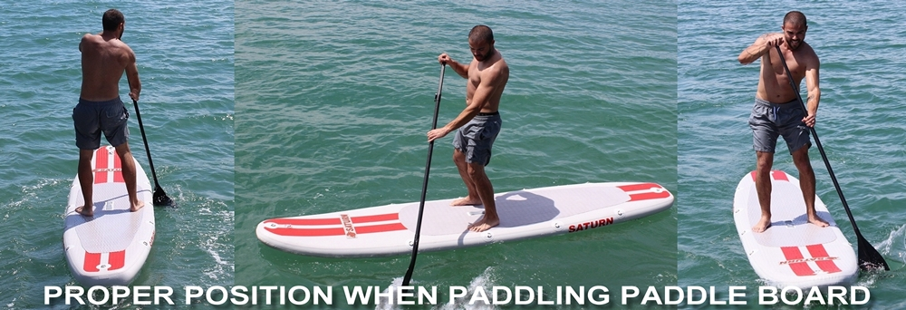 Proper position paddling stand up paddle board.